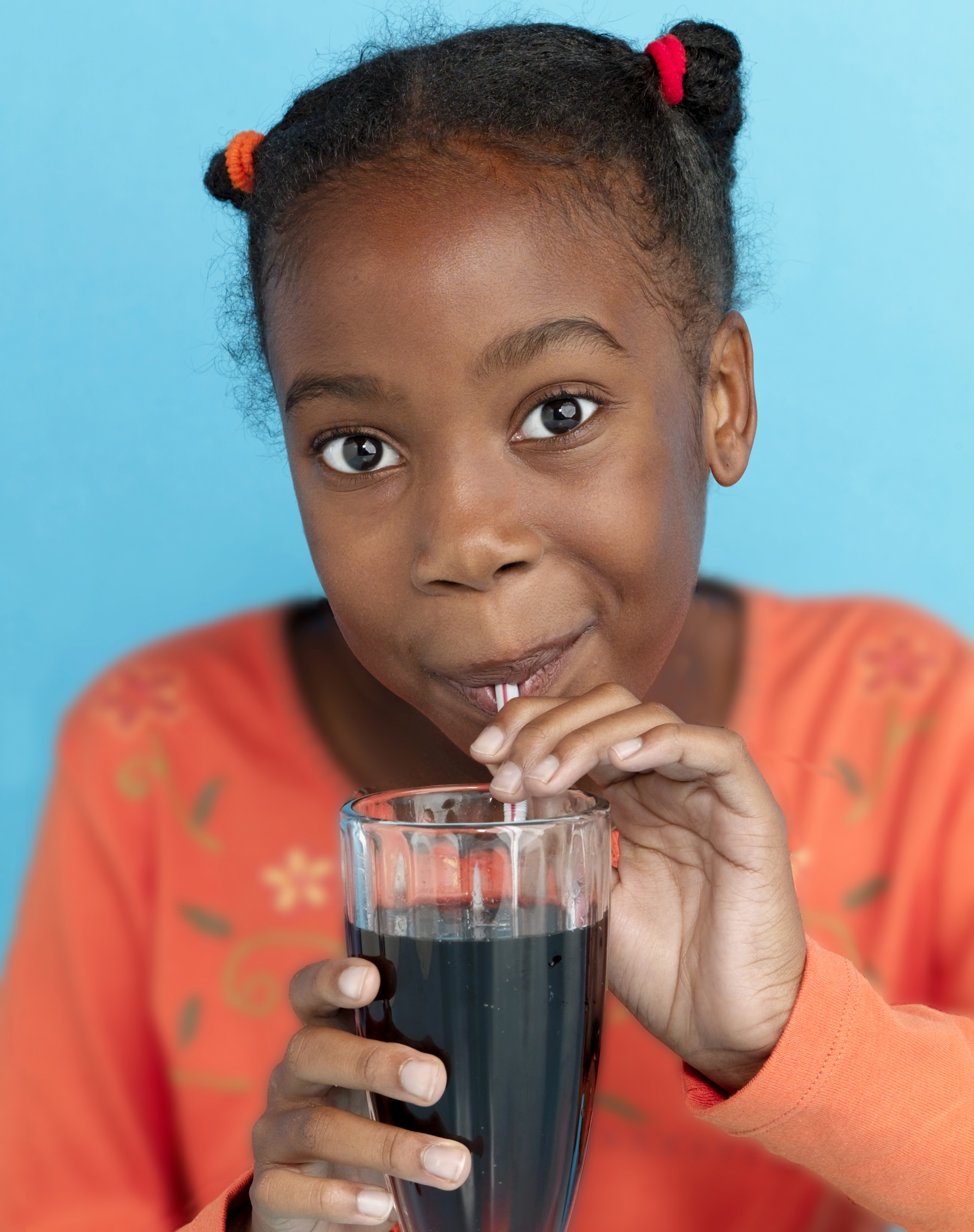 girl drinking root beer with straw