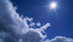 Scattered cumulus clouds and bright sun