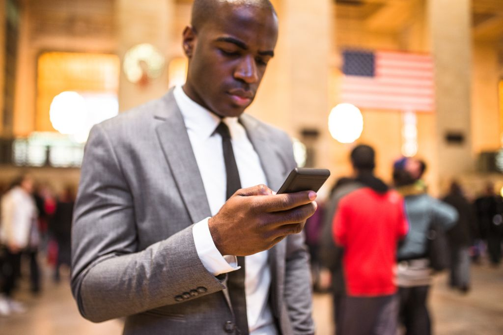 business man portrait in nyc sending sms