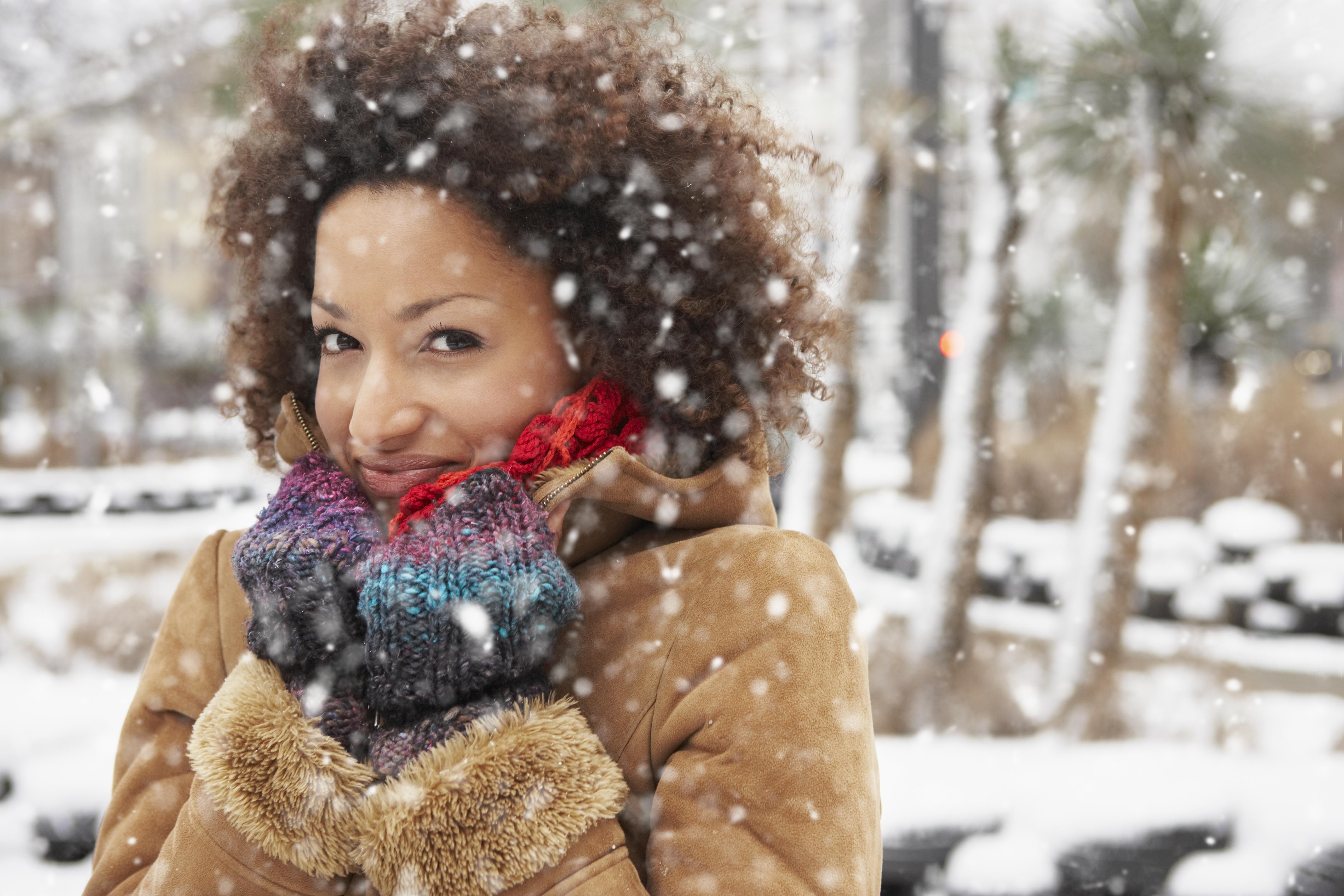 Young woman enjoying snowfall