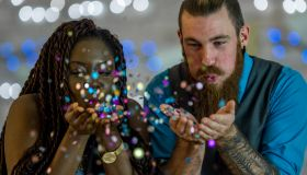 Couple Blowing Glitter Out of Their Hands