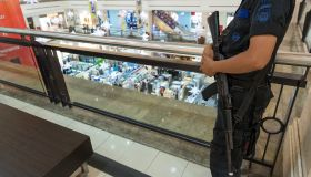 Man with an assault rifle in a supermarket