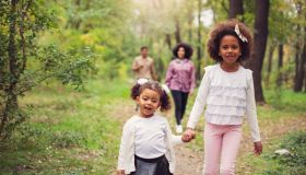 Carefree family having fun while walking in spring day outdoors.
